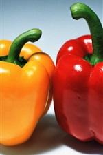 Rote und orange Paprika
