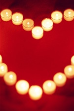 Preview iPhone wallpaper Warm and loving heart shaped candle
