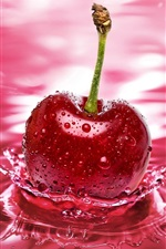Preview iPhone wallpaper Red cherry falling into the water the moment
