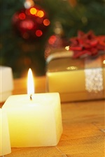 Preview iPhone wallpaper Christmas candles and gifts