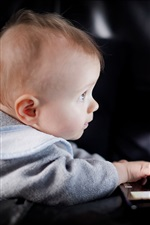 Preview iPhone wallpaper Cute baby boy use laptop