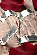 Preview iPhone wallpaper Heart-shaped metal ring
