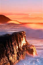 Lighthouse sea waves rocks cliffs sunset