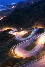 Preview iPhone wallpaper Bend along the tortuous downhill road at night