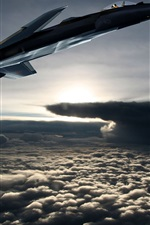 Preview iPhone wallpaper Fighter aircraft flying out of the clouds