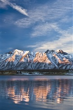 Preview iPhone wallpaper Lake and snow-capped mountains in winter