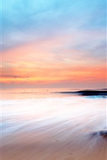 Preview iPhone wallpaper Sunset's glow sea