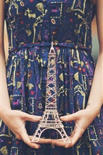 Preview iPhone wallpaper The girl hands Eiffel Tower model