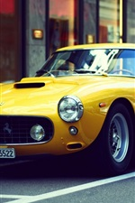 Preview iPhone wallpaper Ferrari yellow retro car