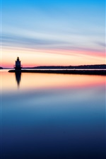 Lighthouse water reflection in morning