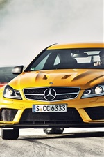 Preview iPhone wallpaper Mercedes-Benz C63 AMG yellow and BMW M3 GTS red supercar
