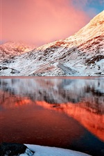 Preview iPhone wallpaper Winter lake, snow-capped mountains, the red glow beauty