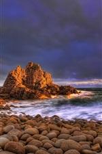 The ocean waves, rocks beach sunset clouds