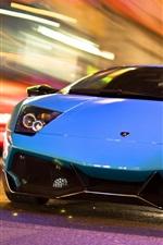Lamborghini blue car in the city night road