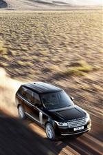 Land Rover in the desert at high speeds