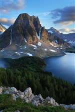 Mountains, natural lakes and forest trees, blue sky