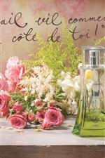 Still Life on the desktop, perfume, pink roses, photo frames