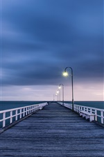Preview iPhone wallpaper Australian landscape, wooden bridge, night lights, blue sea and sky
