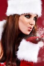 Christmas girl blowing snowflakes