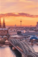 Preview iPhone wallpaper Urban landscape, Cologne, Germany, sunset sky, the Rhine, bridge, buildings