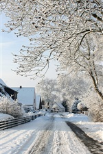 Preview iPhone wallpaper Village town snow landscape, thick snow, road, houses, trees
