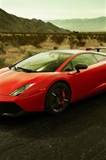 Red Lamborghini gallardo LP570-4 at outdoor mountain road