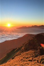 Preview iPhone wallpaper High-altitude mountain sunrise, floating clouds, sun
