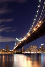 Night in New York, the lights, the bridge, the river, high-rise buildings