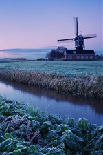 Preview iPhone wallpaper Netherlands winter morning, sunrise, farm, windmill, frost, river, blue sky