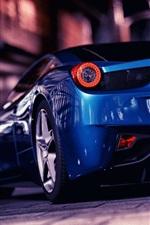 Ferrari blue supercar at city street
