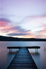 Preview iPhone wallpaper Ireland landscape, river, water surface, wooden bridge, dawn, purple sky
