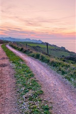Preview iPhone wallpaper Spain scenery, road, footpath, grass, coast, sea, evening sunset
