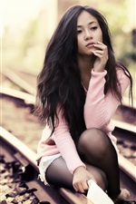 Preview iPhone wallpaper Asian girl on the tracks