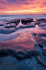 Preview iPhone wallpaper Sunset sea coast, red sky, rocks