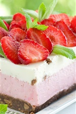 Cream cake, fresh strawberries, green leaves