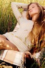 Preview iPhone wallpaper Girl relaxing in grass