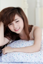 Preview iPhone wallpaper Pure girl in bed smiling