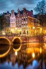 Preview iPhone wallpaper Amsterdam, Nederland, city, evening, lights, river, bridge, houses, trees