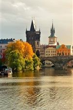 Preview iPhone wallpaper Prague, Charles Bridge, the river Vltava, water, boats, houses, autumn