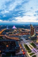 Preview iPhone wallpaper Astana, Kazakhstan, city landscape, dusk, lights, buildings, clouds