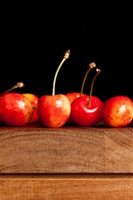 Preview iPhone wallpaper Delicious red cherry, wooden table