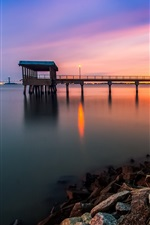 Dusk pier, rocks, water, sunset
