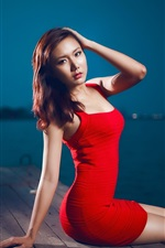 Preview iPhone wallpaper Red dress asian girl sitting at pier night