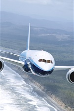 Preview iPhone wallpaper Boeing 737 airplane, flying on the sea
