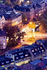 Preview iPhone wallpaper Freiburg im Breisgau, Germany, city houses, buildings, roads, evening