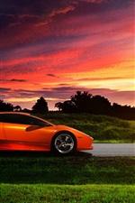 Preview iPhone wallpaper Lamborghini orange supercar at sunset