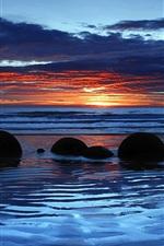 Preview iPhone wallpaper Moeraki Boulders, Koekohe Beach, Otago, New Zealand, sunset, clouds