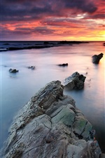 Sunrise, rocks, Collywell Bay, Northumberland, England