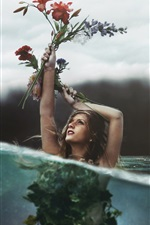 Preview iPhone wallpaper Girl hold up flowers in the water, creative pictures