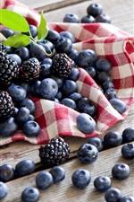 Berries, blueberries, blackberries, wood board
